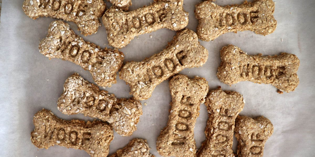 Overhead shot of bone shaped dog treats with the word