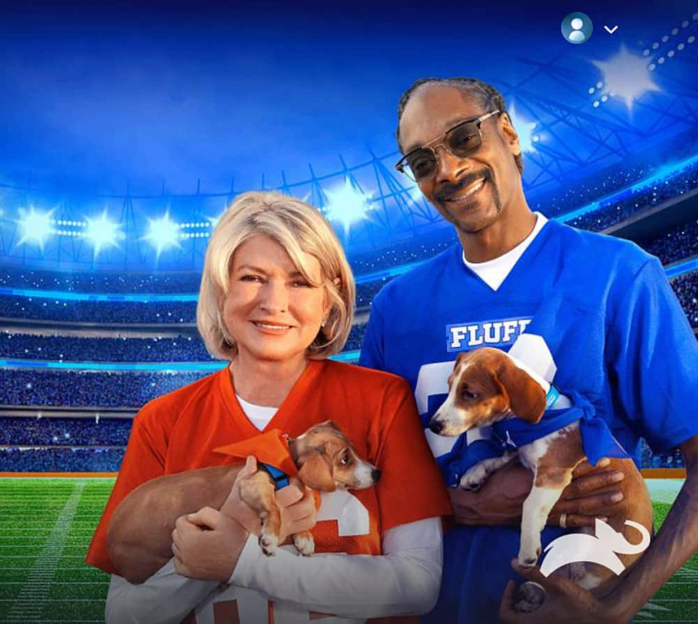 Martha Stewart and Snoop Dog for Puppy Bowl 2021 holding two adorable puppies!